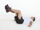 Abdominal com flexão de quadril e pernas estendidas